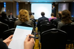 training conference taking notes bear bull and co corporate sales trainer sales coach motivational speaker
